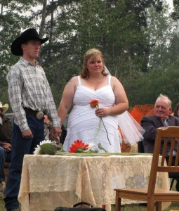 A picture of Mat and Jenny's wedding, with Sandy looking on.